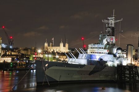 HMS Belfast with Tower of London at night