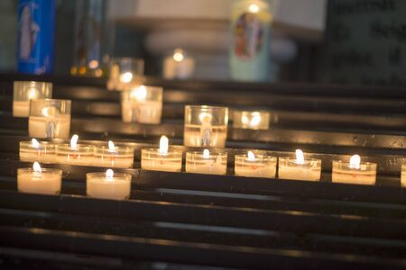 Devotional candles burning in a church Stock Photo