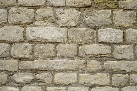 Old stone wall with cement and stones