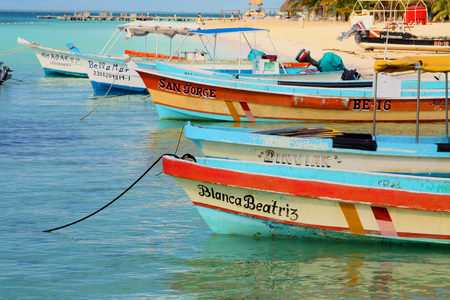 boats lined up on water isla mujeres
