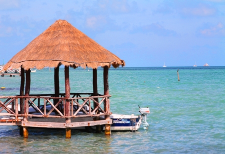 carribean: Tiki hut over carribean waters