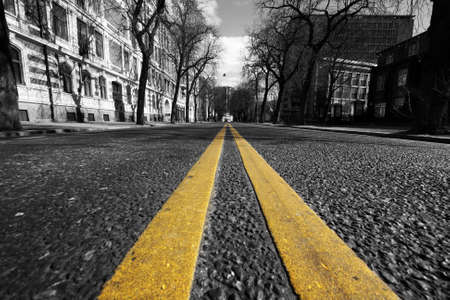 double yellow lines in city street photo