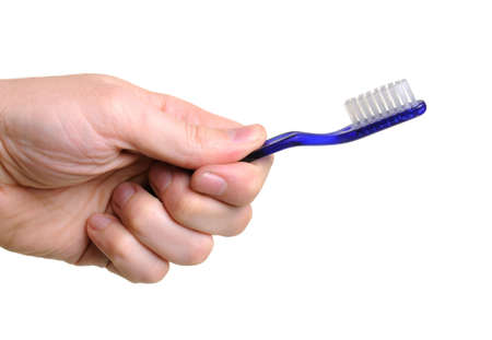 hand holding blue toothbrush over white background Stock Photo - 4166861