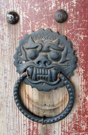 superstitions: traditional asian temple door handle