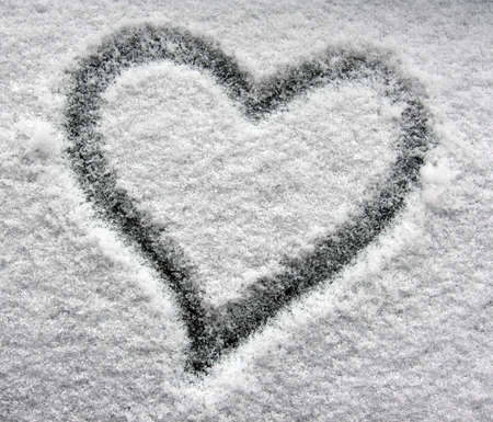heart on snowy window photo