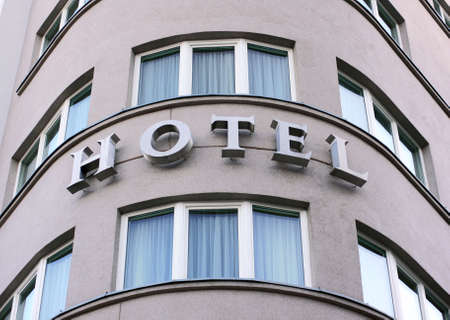 hotel sign in exterior view on a rounded front of building