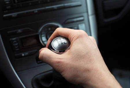 levers: close up of hand on manual gear shift knob