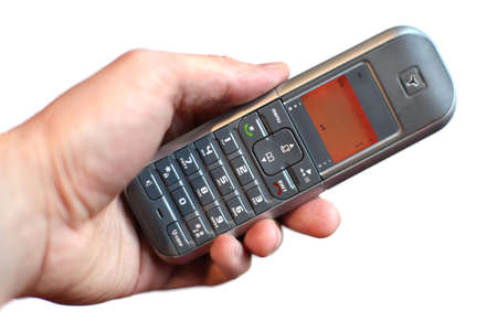 hand holding cordless phone isolated on white background photo