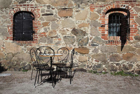 iron chairs and table outside traditional house Stock Photo - 4708498
