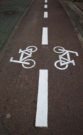 double sign on tarmac bicycle Stock Photo - 4972379