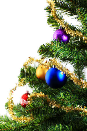 Xmas decorations on christmas tree over white background photo
