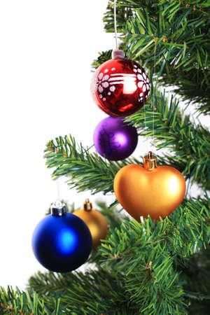 Xmas decorations on christmas tree over white background Stock Photo - 5891332