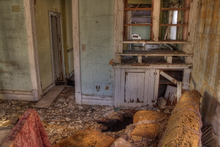 An Abandoned Farm House decays forgotten in rural South Dakota Stock Photo