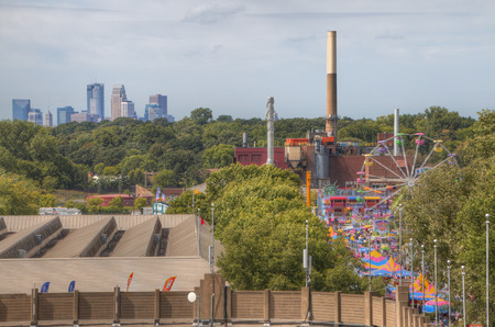 The Minnesota State fair is the largest gathering in Minnesota and millions of people attend during the two weed period. Фото со стока