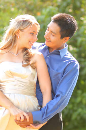 Young Interracial Couple Dressed Up photo