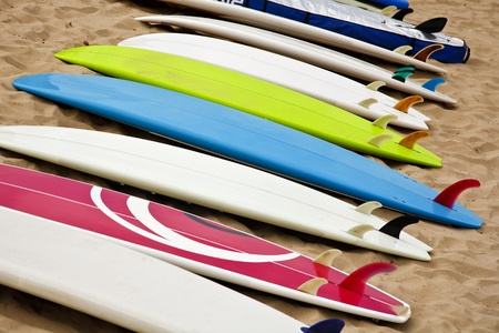 Colorful surf boards on the beach photo