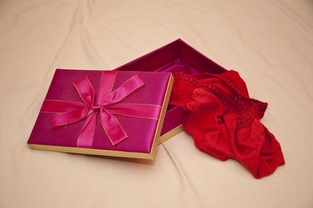 red panties: Gift of red panties Stock Photo