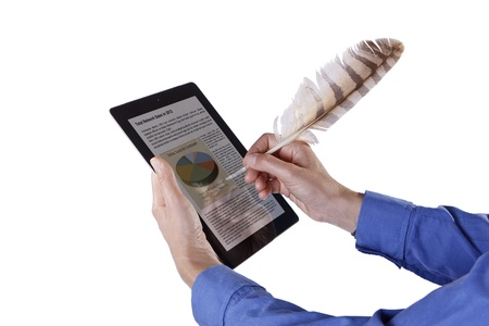 Spain - July 15, 2012: Businessman hands are holding and write with plume on screen device. Isolated on white.