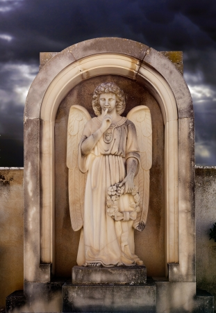 angel cemetery: Angel on a grave stone in the cemetery  Silence