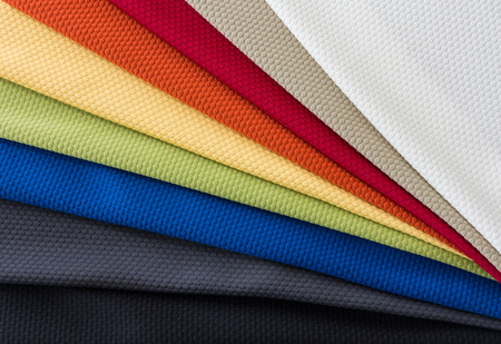 upholster: Different Multi colored fabrics for upholstered furniture, chairs, sofas, etc  in a fan