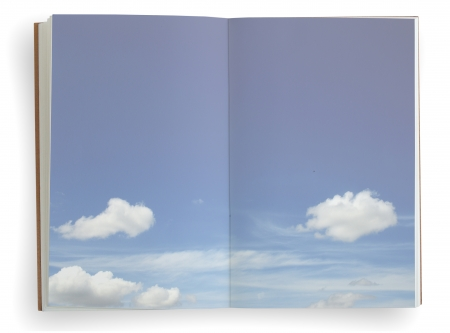 Open notebook with blue sky and cloud background. photo