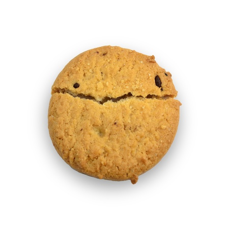 has: Cookie has smiley face isolated on white.