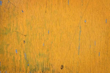painted wood: Grunge wood wall painted in yellow. Stock Photo
