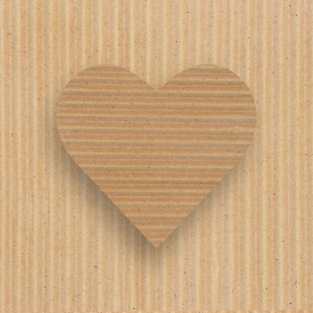 Heart shape on grunge brown paper background. photo