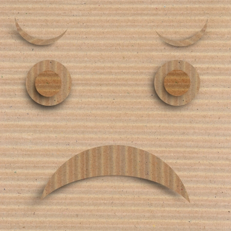 disapprove: Angry face on brown recycle paper background.