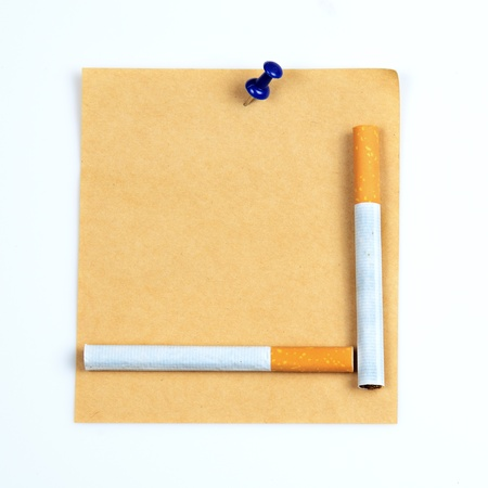vetical: Cigarettes on brown notepad. Stock Photo
