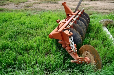 the plough: Old plough in grass field