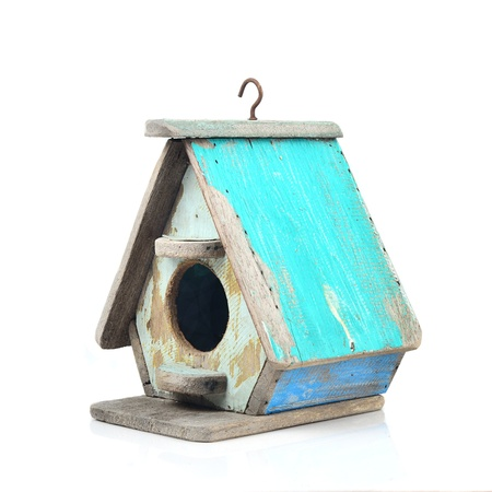 Bird's house made from wood in vintage style isolated on white. photo