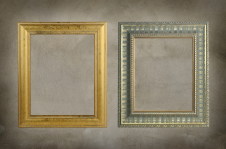 Two vintage frame on cement wall. photo