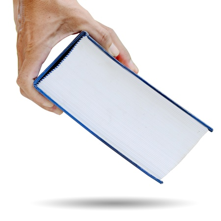 Man hand picking up a thick book. photo