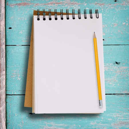 copy writing: Open blank notebook on grunge wood background in green color with yellow pencil. Stock Photo