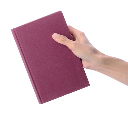 note book: Mans hand picking blank red book on white background