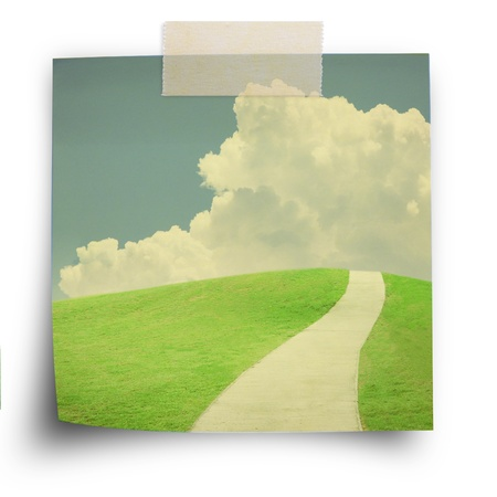 paveway: Nature background, green field and sky, on sticker paper note with scoth strip in vintage style Stock Photo