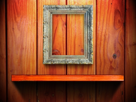 Classic golden frame on wood wall and shelf with light and shadow photo