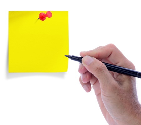 Man hand with pen and blank paper note with red pushpin photo