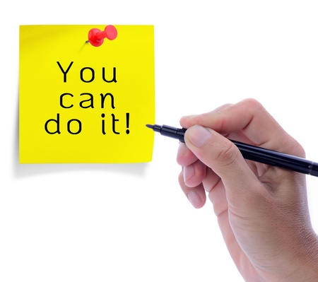 Man hand write on yello paper note with red pushpin in word, you can do it. photo