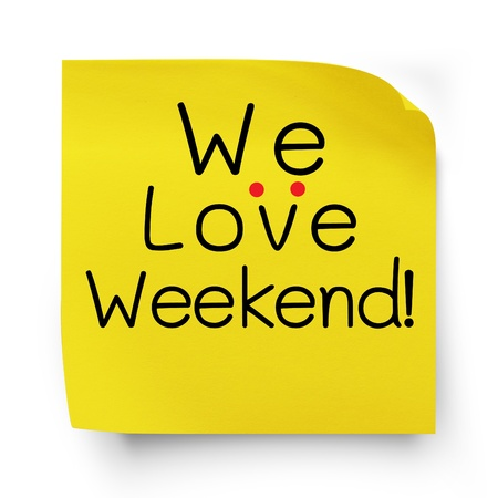 we: We love weekend note message on yellow sticker paper note isolated on white with clipping  path