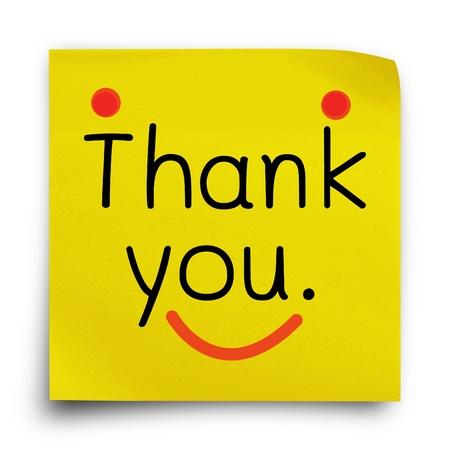 白い背景の上の黄色のステッカー用紙メモにありがとう言葉