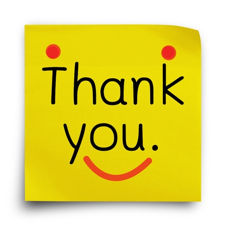 Thank you word on yellow sticker paper note on white background photo