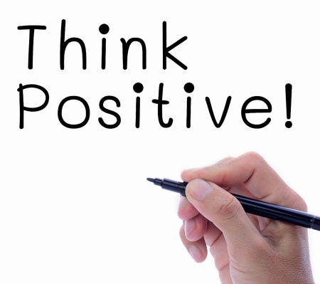 Man hand writing word, Think Positive, in white space photo