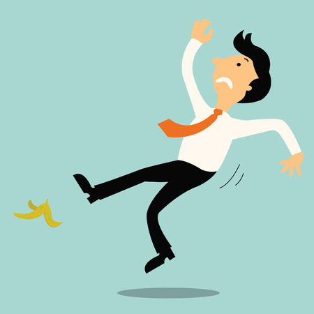 carelessness: Young businessman slip on banana peel and falling down.