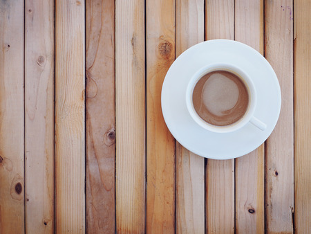 freshment: Hot coffee on wood background. Top view.