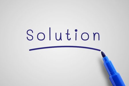 annoucement: Blue pen marker with word solution, business concept in solution note, gray background.