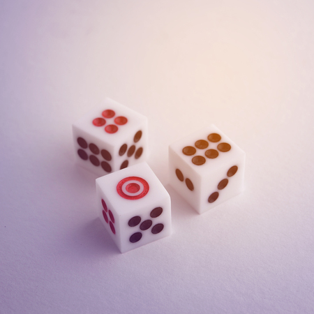 group strategy: Group of dice with shadadow and light glow.