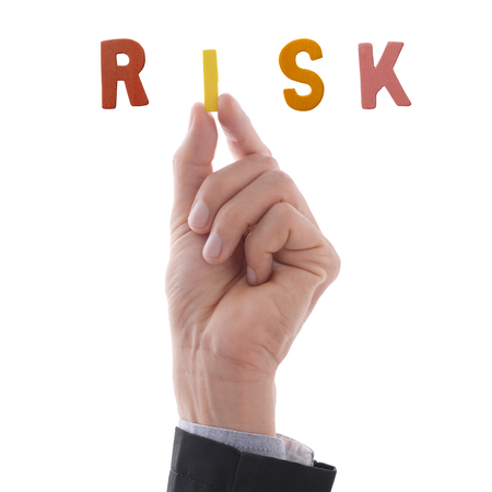 Business mans hand holding i alphabet to complete making word, risk. Business concept in risk situation. Stok Fotoğraf