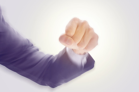 blur effect: Business mans hand hold fist and punch, isolated on white background, motion radial blur effect, business concept in fight or strength.